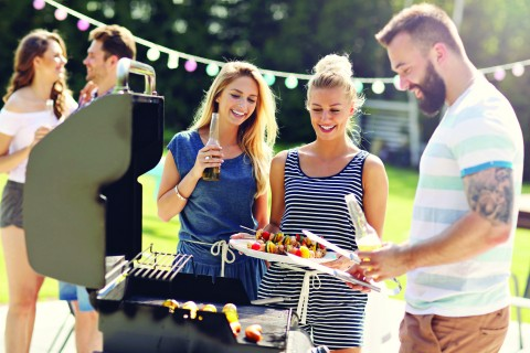 Picture showing group of friends having barbecue party in backyard